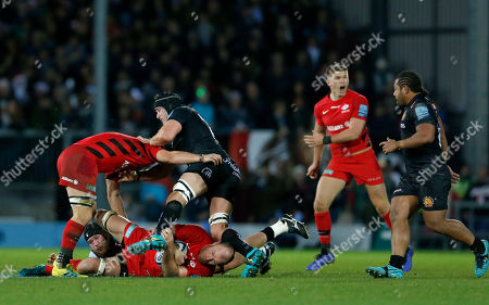 Schalk Burger of Saracens goes into a breakdown, Owen Farrell can be seen shouting orders in the background