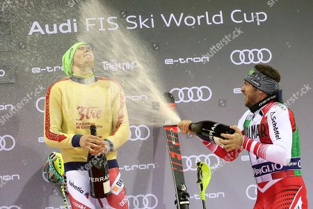 Winner Daniel Yule (L) of Switzerland and third placed Michael Matt (R) of Austria celebrate on the podium after the Men's Slalom race at the FIS Alpine Skiing World Cup in Madonna di Campiglio, Italy, 22 December 2018.