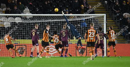 Kristoffer Nordfeldt goalkeeper of Swansea City fails to stop Tommy Elphick of Hull City (out of frame) scoring his side's second goal