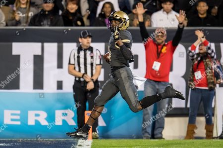 Stock Picture of Army Black Knights quarterback Cam Thomas (4) rushes for a touchdown during the 4th quarter of the Armed Forces Bowl NCAA football game between the Army Black Knights and the Houston Cougars at Amon G. Carter Stadium in Fort Worth, TX. Army won the game 70 to 14