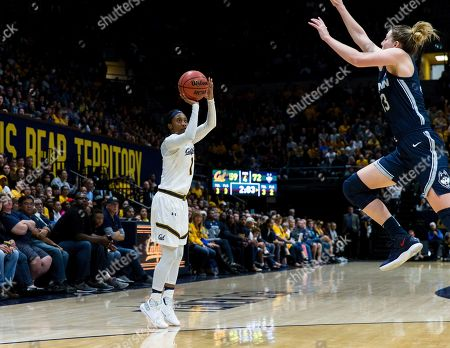California Golden Bears guard Asha Thomas (1) takes a three-point shot as Connecticut Huskies guard/forward Katie Lou Samuelson (33) defends in the fourth quarter of an NCAA college basketball game, in Berkeley, Calif
