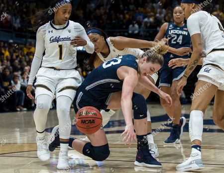 Connecticut Huskies guard/forward Katie Lou Samuelson, center, loses possession after colliding with California Golden Bears guard Asha Thomas (1) and forward Alaysia Styles, right, in the second quarter of an NCAA college basketball game, in Berkeley, Calif