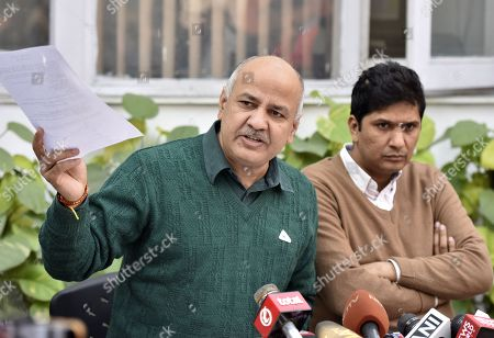 Stock Picture of Deputy Chief Minister of Delhi Manish Sisodia with AAP MLA and Spokesperson Saurabh Bhardwaj address a press conference on the issue of not supporting a resolution in the assembly on revoking late PM Rajiv Gandhi's Bharat Ratna and on the issue of AAP MLA Alka Lamba?s resignation at Mathura Road on December 22, 2018 in New Delhi, India.