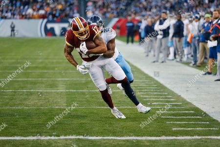Washington Redskins wide receiver Michael Floyd (17) scores a touchdown on a 7-yard reception as he is defended by Tennessee Titans cornerback Adoree' Jackson (25) in the first half of an NFL football game, in Nashville, Tenn