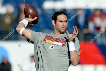 Washington Redskins quarterback Mark Sanchez warms up before an NFL football game against the Tennessee Titans, in Nashville, Tenn