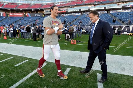 Stock Picture of Washington Redskins quarterback Mark Sanchez, left, talks with broadcaster and former coach Steve Mariucci before an NFL football game between the Redskins and the Tennessee Titans, in Nashville, Tenn