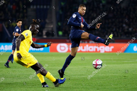 Kylian Mbappe of Paris Saint Germain (R) in action against Kara Mbodji of FC Nantes during the French League 1 soccer match between the Paris Saint-Germain and the FC Nantes at the Parc des Princes stadium in Paris, France, 22 December 2018.
