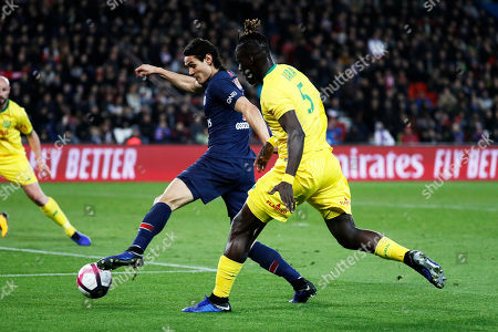 Stock Image of Edinson Cavani of Paris Saint Germain (L) in action against Kara Mbodji of FC Nantes during the French League 1 soccer match between the Paris Saint-Germain and the FC Nantes at the Parc des Princes stadium in Paris, France, 22 December 2018.