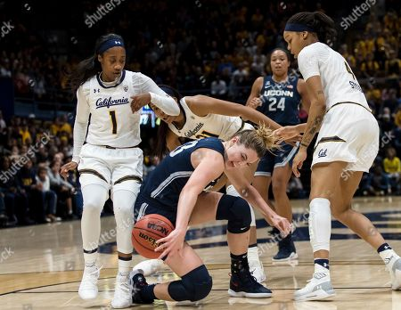 Connecticut guard/forward Katie Lou Samuelson, center, loses possession after colliding with California guard Asha Thomas (1) and forward Alaysia Styles, right, in the second quarter of an NCAA college basketball game, in Berkeley, Calif