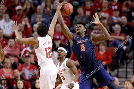 Glynn Watson Jr., Davon Clare, Thomas Allen. Nebraska's Glynn Watson Jr. (5) watches as Thomas Allen (12) and Cal State Fullerton's Davon Clare (5) compete for a rebound, during the first half of an NCAA college basketball game in Lincoln, Neb