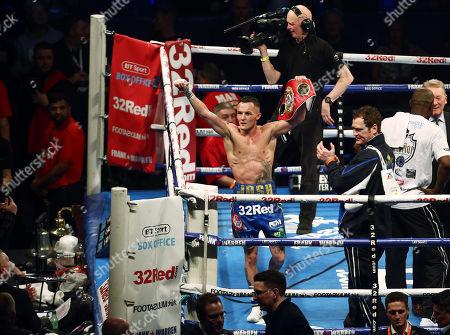 Josh Warrington celebrates after the IBF World Featherweight title fight