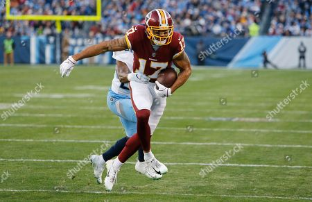 Washington Redskins wide receiver Michael Floyd (17) scores a touchdown on a 7-yard reception as he is defended by Tennessee Titans cornerback Adoree' Jackson in the first half of an NFL football game, in Nashville, Tenn