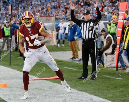 Washington Redskins wide receiver Michael Floyd (17) celebrates after scoring a touchdown on a 7-yard reception against the Tennessee Titans in the first half of an NFL football game, in Nashville, Tenn