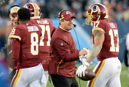 Washington Redskins wide receiver Michael Floyd (17) celebrates with Redskins head coach Jay Gruden after Floyd scored a touchdown against the Tennessee Titans in the first half of an NFL football game, in Nashville, Tenn