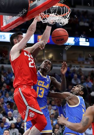 Kyle Young, Kris Smith, Cody Riley. Ohio State forward Kyle Young, left, dunks against UCLA guard Kris Smith, center, and forward Cody Riley during the second half of an NCAA college basketball game in the fifth annual CBS Sports Classic, in Chicago