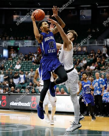 Indiana State guard Christian Williams (10) shoots over Colorado forward Lucas Siewert (23) during the second half of an NCAA college basketball game at the Diamond Head Classic, in Honolulu