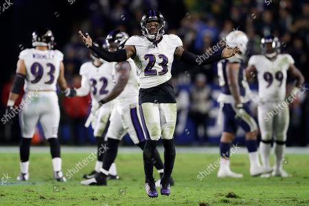 Stock Photo of Baltimore Ravens strong safety Tony Jefferson celebrates after a touchdown by Tavon Young on a fumble by Los Angeles Chargers tight end Antonio Gates during the second half in an NFL football game, in Carson, Calif