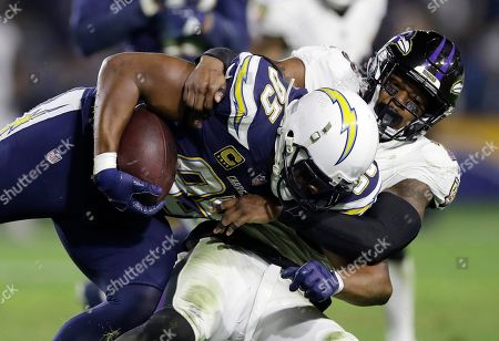 Stock Image of Los Angeles Chargers tight end Antonio Gates, left, is tackled by Baltimore Ravens strong safety Tony Jefferson during an NFL football game, in Carson, Calif