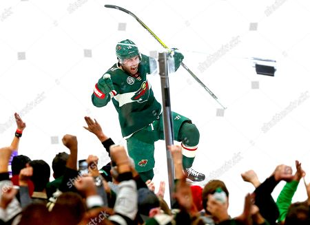 Stock Image of Minnesota Wild's Jason Zucker celebrates his third period goal off Dallas Stars goalie Ben Bishop to tie the NHL hockey game, in St. Paul, Minn. The Stars won 2-1 in overtime