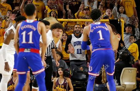NBA legend Grant Hill paricipates in the Curtain of Distraction in the second half during an NCAA college basketball game between Arizona State and Kansas, in Tempe, Ariz. Arizona State defeated Kansas 80-76
