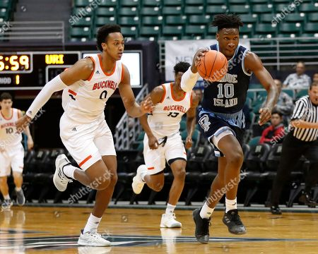 Rhode Island forward Cyril Langevine (10) steals the ball and heads to the net while being chased by Bucknell center Paul Newman (0) during the first half of an NCAA college basketball game at the Diamond Head Classic, in Honolulu