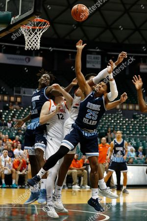Rhode Island forward Cyril Langevine (10), Bucknell forward John Meeks (12), Bucknell center Paul Newman (0) and Rhode Island guard Christion Thompson (25) fight for a rebound during the first half of an NCAA college basketball game at the Diamond Head Classic, in Honolulu