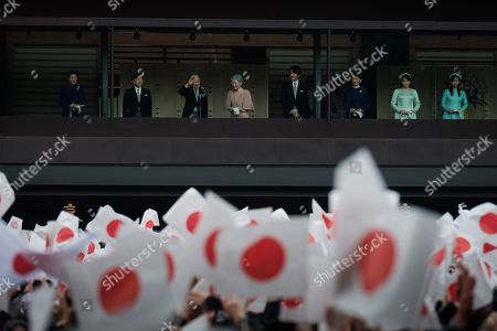 (From left to right) Crown Princess Masako, Crown Prince Naruhito, Japan's Emperor Akihito, accompanied by his wife Empress Michiko, Prince Akishino Fumihito, Princess Akishino Kiko, Princess Mako and Princess Kako appear on the balcony of the Imperial Palace to mark the emperor's 85th birthday