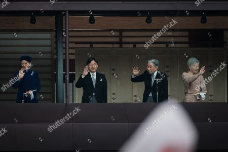 (From left to right) Crown Princess Masako, Crown Prince Naruhito, Japan's Emperor Akihito, accompanied by his wife Empress Michiko wave to well-wishers as they appear on the balcony of the Imperial Palace to mark the emperor's 85th birthday