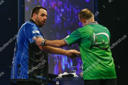Adrian Lewis celebrates after his Third Round match against Darius Labanauskas in the World Darts Championships 2018 at Alexandra Palace, London