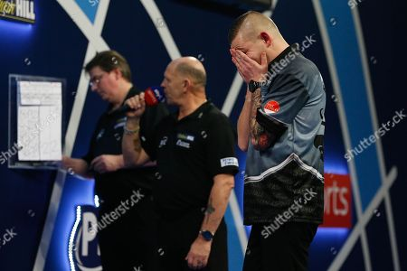 WINNER Nathan Aspinall holds his face and cannot believe it after winning his Third Round match against Kyle Anderson during the World Darts Championships 2018 at Alexandra Palace, London