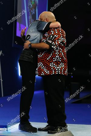 WINNER Nathan Aspinall embraces Kyle Anderson after his Third Round victory during the World Darts Championships 2018 at Alexandra Palace, London