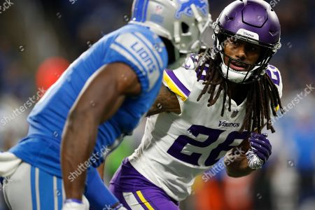 Minnesota Vikings cornerback Trae Waynes (26) follows Detroit Lions wide receiver Andy Jones during the second half of an NFL football game, in Detroit