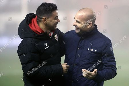 Rayo Vallecano's head coach Miguel Angel Sanchez (L) greets UD Levante's head coach Paco Lopez (R) before their Spanish Liga Primera Division soccer match played at Estadio de Vallecas stadium in Madrid, Spain, 23 December 2018.