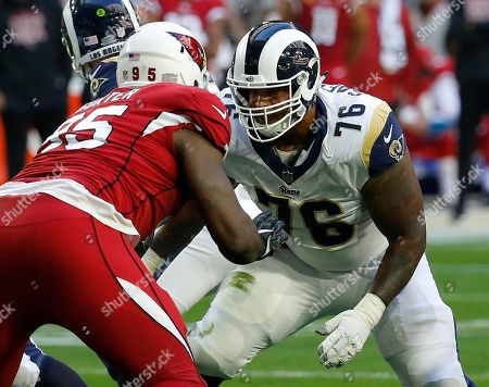 Los Angeles Rams offensive guard Rodger Saffold (76) during the first half of an NFL football game against the Arizona Cardinals, in Glendale, Ariz