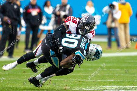 Atlanta Falcons outside linebacker De'Vondre Campbell (59) tackles Carolina Panthers tight end Ian Thomas (80) in the NFL matchup at Bank of America Stadium in Charlotte, NC