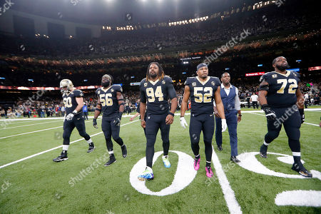 New Orleans Saints center Max Unger (60), outside linebacker Demario Davis (56), defensive end Cameron Jordan (94), linebacker Craig Robertson (52) and offensive tackle Terron Armstead (72) walk onto the field for the coin toss before an NFL football game against the Pittsburgh Steelers in New Orleans