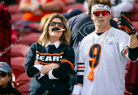 Chicago Bears fans dress as Mike Ditka and Jim McMahon prior to the NFL football game between the Chicago Bears and the San Francisco 49ers at Levi's Stadium in Santa Clara, CA