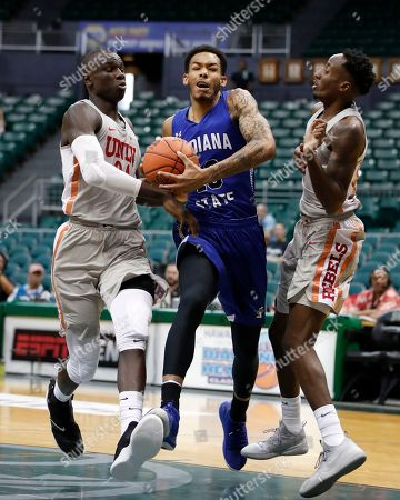 Indiana State guard Christian Williams (10) runs to the net through UNLV forward Cheikh Mbacke Diong (34) and guard Kris Clyburn (1) during the first half of an NCAA college basketball game at the Diamond Head Classic, in Honolulu