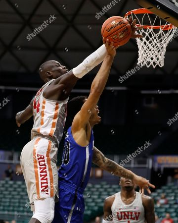 UNLV forward Cheikh Mbacke Diong (34) blocks the shot of Indiana State guard Christian Williams (10) during the first half of an NCAA college basketball game at the Diamond Head Classic, in Honolulu