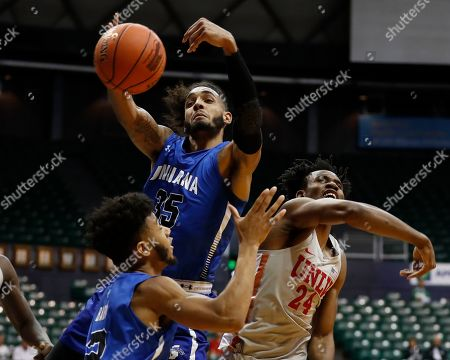 Stock Image of Indiana State guard Jordan Barnes (2), forward Devin Thomas (35) and UNLV forward Joel Ntambwe (24) fight for a rebound during the first half of an NCAA college basketball game at the Diamond Head Classic, in Honolulu