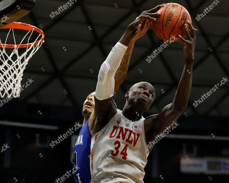 UNLV forward Cheikh Mbacke Diong (34) grabs a rebound away from Indiana State guard Christian Williams (10) during the first half of an NCAA college basketball game at the Diamond Head Classic, in Honolulu