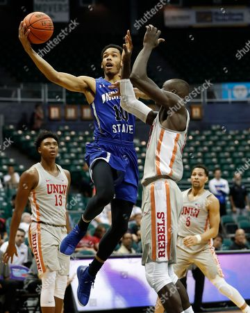 Indiana State guard Christian Williams (10) goes to the net over UNLV forward Cheikh Mbacke Diong (34) during the first half of an NCAA college basketball game at the Diamond Head Classic, in Honolulu