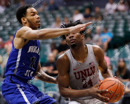 Indiana State guard Christian Williams (10) guards UNLV forward Joel Ntambwe (24) during the second half of an NCAA college basketball game at the Diamond Head Classic, in Honolulu