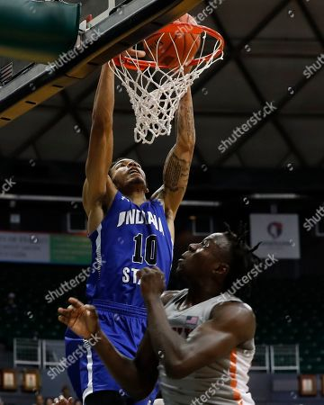 Indiana State guard Christian Williams (10) dunks the ball over UNLV guard Bryce Hamilton (13) during the second half of an NCAA college basketball game at the Diamond Head Classic, in Honolulu