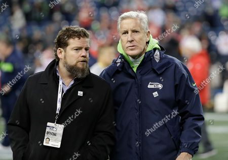 Seattle Seahawks head coach Pete Carroll, right, talks with Seattle Seahawks general manager John Schneider, left, before an NFL football game against the Kansas City Chiefs, in Seattle