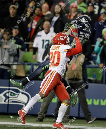 Seattle Seahawks wide receiver Doug Baldwin (89) makes a catch for touchdown above Kansas City Chiefs cornerback Steven Nelson (20), during the second half of an NFL football game, in Seattle