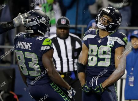 Seattle Seahawks wide receiver Doug Baldwin (89) celebrates with wide receiver David Moore after Baldwin scored a touchdown against the Kansas City Chiefs during the second half of an NFL football game, in Seattle