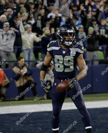 Seattle Seahawks wide receiver Doug Baldwin reacts after he scored a touchdown against the Kansas City Chiefs during the second hal'f of an NFL football game, in Seattle