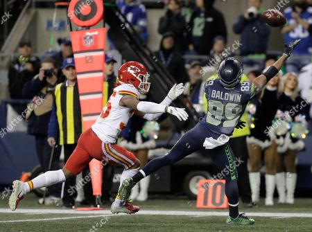 Seattle Seahawks wide receiver Doug Baldwin (89) makes a catch ahead of Kansas City Chiefs cornerback Charvarius Ward, right, during the second half of an NFL football game, in Seattle. The Seahawks won 38-31