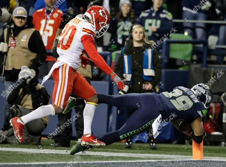 Seattle Seahawks wide receiver Doug Baldwin (89) comes down in bounds for a touchdown after a reception as Kansas City Chiefs cornerback Steven Nelson, left, looks, during the second half of an NFL football game, in Seattle